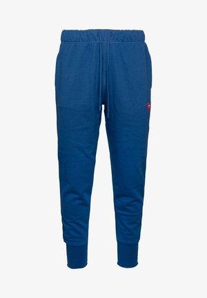 UMLB-PETER  - Tracksuit bottoms - blue