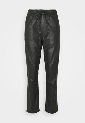 CARA - Trousers - black