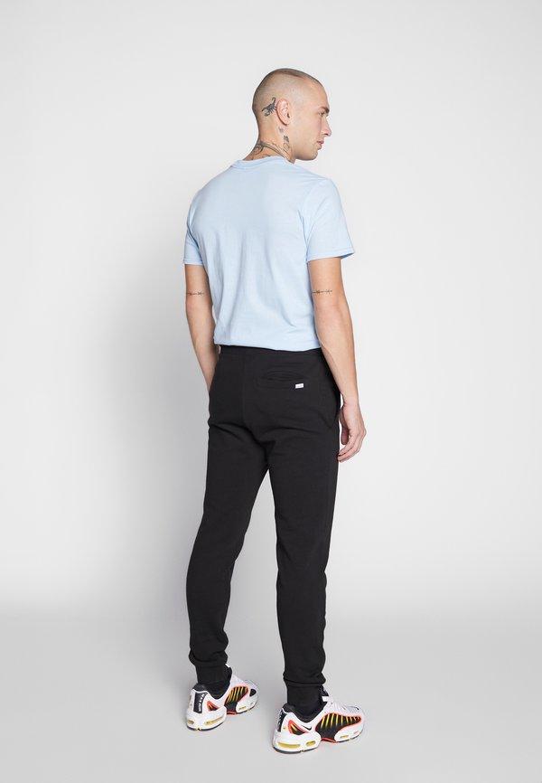 Jack & Jones JJIGORDON - Spodnie treningowe - black/czarny Odzież Męska CIBR