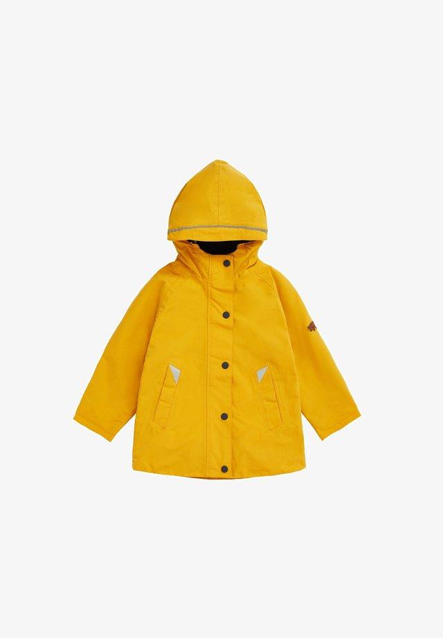 COASTAL WOODLAND - Waterproof jacket - yellow