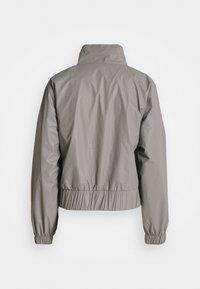 Karl Kani - RETRO SHINY SHORT TRACKJACKET - Summer jacket - grey - 8