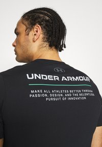 Under Armour - BOXED ALL ATHLETES - Print T-shirt - black - 3
