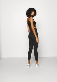 Nike Sportswear - Leggings - black/white - 2