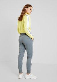 Nike Sportswear - PANT - Tracksuit bottoms - cool grey/white - 2