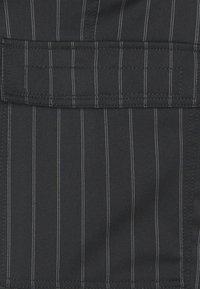 Versace Jeans Couture - TECNICAL STRIPES BARRE - Pantaloni sportivi - nero - 2