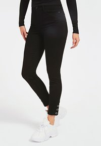 Guess - Jeans Skinny Fit - schwarz - 0