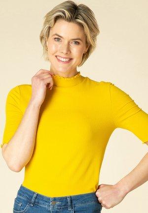 THYRA - Basic T-shirt - dark yellow