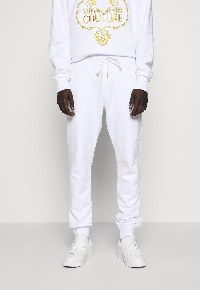 BASIC JOGGERS - Träningsbyxor - white