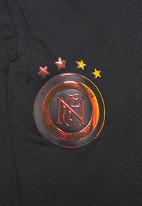 Nike Performance - FC PANT - Spodnie treningowe - black/iridescent/habanero red - 8