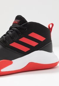 adidas Performance - OWNTHEGAME WIDE - Sports shoes - core black/active red/footwear white - 5