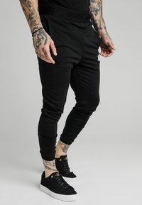 SIKSILK - AGILITY TRACK PANTS - Tracksuit bottoms - black - 4