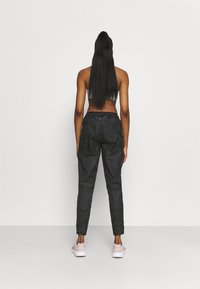 Nike Performance - RUN PANT - Pantalones deportivos - black/gold - 2