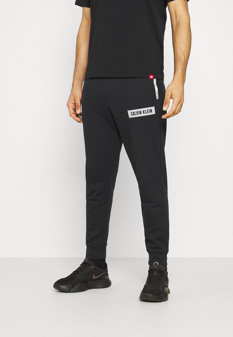 Calvin Klein Performance - PANT - Teplákové kalhoty - black