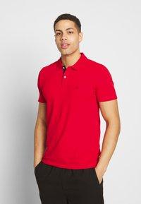 Selected Homme - SLHLUKE SLIM FIT - Polo shirt - true red - 0
