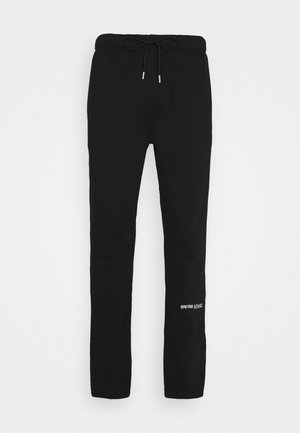 LOGO PANTS UNISEX - Trousers - black