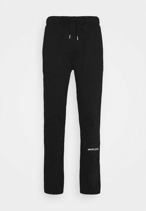 LOGO PANTS UNISEX - Pantalon de survêtement - black