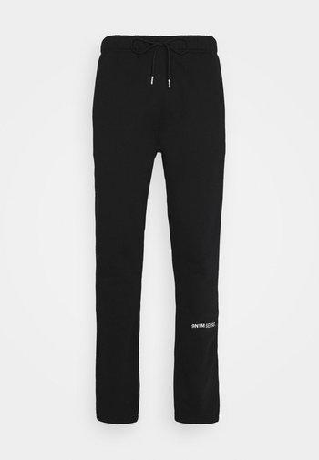 LOGO PANTS UNISEX - Tracksuit bottoms - black