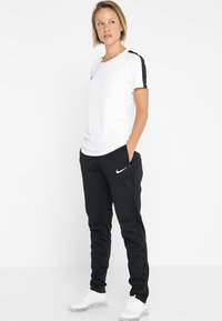 Nike Performance - DRY PANT  - Tracksuit bottoms - black/black/white - 1