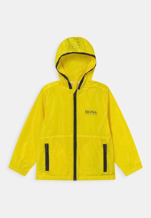 WINDBREAKER - Light jacket - yellow