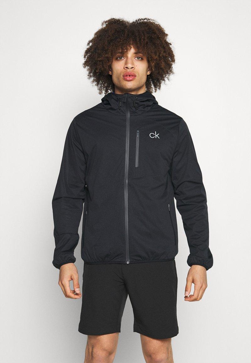 Calvin Klein Golf - ULTRON HOODED JACKET - Waterproof jacket - navy