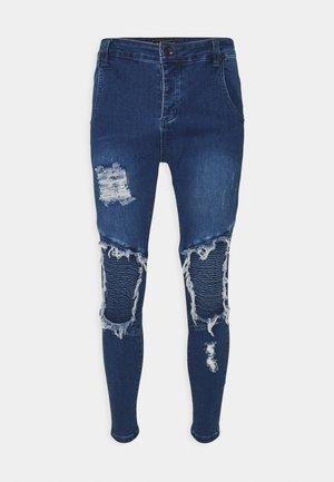 RAW HEM BIKER - Jeans Skinny Fit - midstone blue