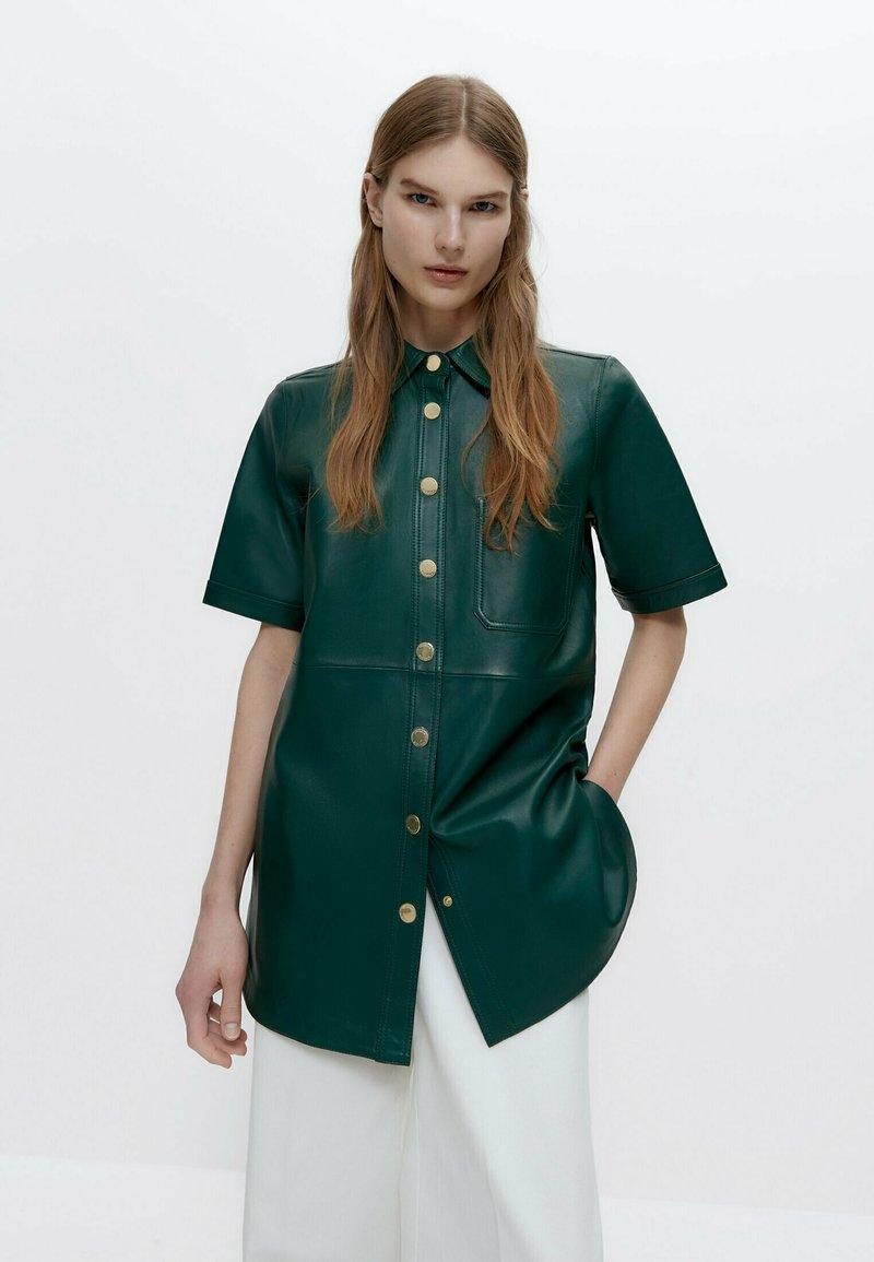 Uterqüe - Leather jacket - green