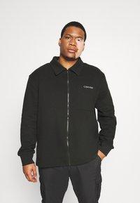 Calvin Klein - JACKET - Zip-up sweatshirt - black - 0