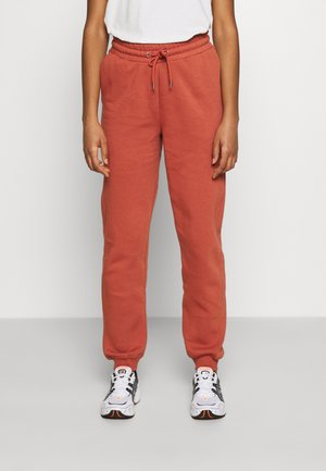 KARDI PANTS - Tracksuit bottoms - orange