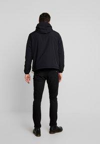 Tommy Jeans - PADDED POPOVER - Light jacket - black - 2