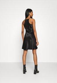 Weekday - NOELLA STRAPPY DRESS - Vestido de cóctel - black - 2