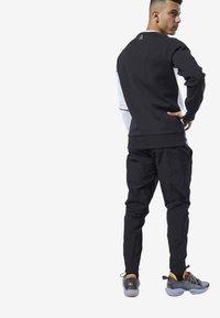 Reebok - ONE SERIES TRAINING COLORBLOCK PANTS - Tracksuit bottoms - black - 2