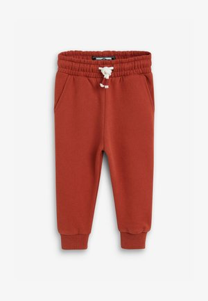 SOFT TOUCH - Tracksuit bottoms - orange