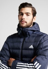 adidas Performance - ITAVIC STRIPES - Winterjacke - dark blue