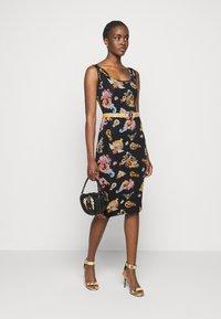 Versace Jeans Couture - LADY DRESS - Vestito di maglina - black - 1