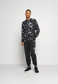 Puma - HOOPS TEE - Long sleeved top - black - 1