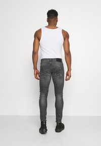 Tigha - BILLY THE KID REPAIRED - Jeans Skinny Fit - vintage black - 2