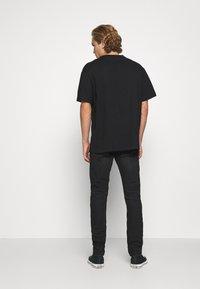 Diesel - THOMMER-X - Slim fit jeans - 069pw - 2