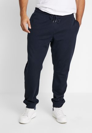 FLOCKED - Tracksuit bottoms - blue