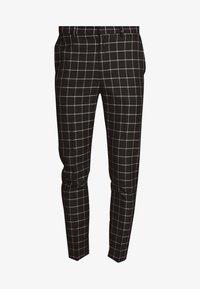 GRID CHECK TROUS - Trousers - black