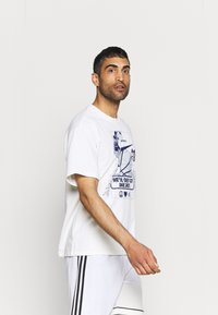 Nike Performance - WE VE ONLY GOT ONE SHOT TEE - Print T-shirt - pure - 3