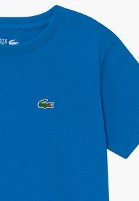 Lacoste Sport - LOGO UNISEX - Basic T-shirt - utramarine - 2