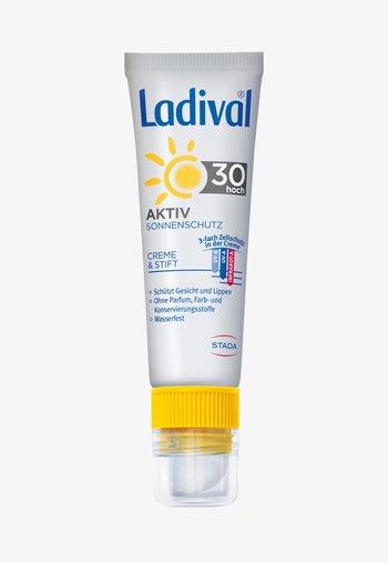 SONNENSCHUTZ AKTIV SONNENSCHUTZ FÜR GESICHT UND LIPPEN LSF 30 - Sun protection - -