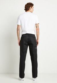 Dickies - DOUBLE KNEE WORK PANT - Stoffhose - black