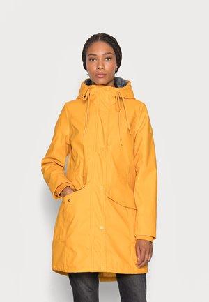 PADDED RAINCOAT - Waterproof jacket - golden pumpkin