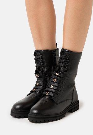 FLUX - Lace-up ankle boots - black