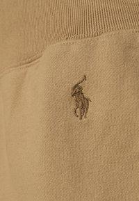 Polo Ralph Lauren - RHINESTONE LOOPBACK - Spodnie treningowe - boating khaki - 5