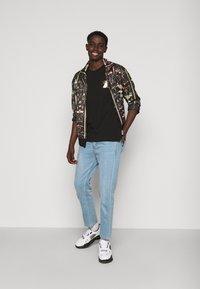 Versace Jeans Couture - FOIL - Print T-shirt - black - 1