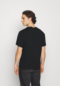 Levi's® - TEE UNISEX - T-shirt con stampa - black - 2