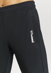 Hummel - HMLZIBA TAPERED PANTS - Pantalon de survêtement - black - 5