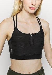 ONLY Play - ONPALANI SPORTS BRA - Medium support sports bra - black/white - 4